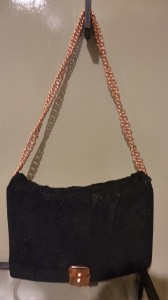 Black chain clutch with rose gold $400