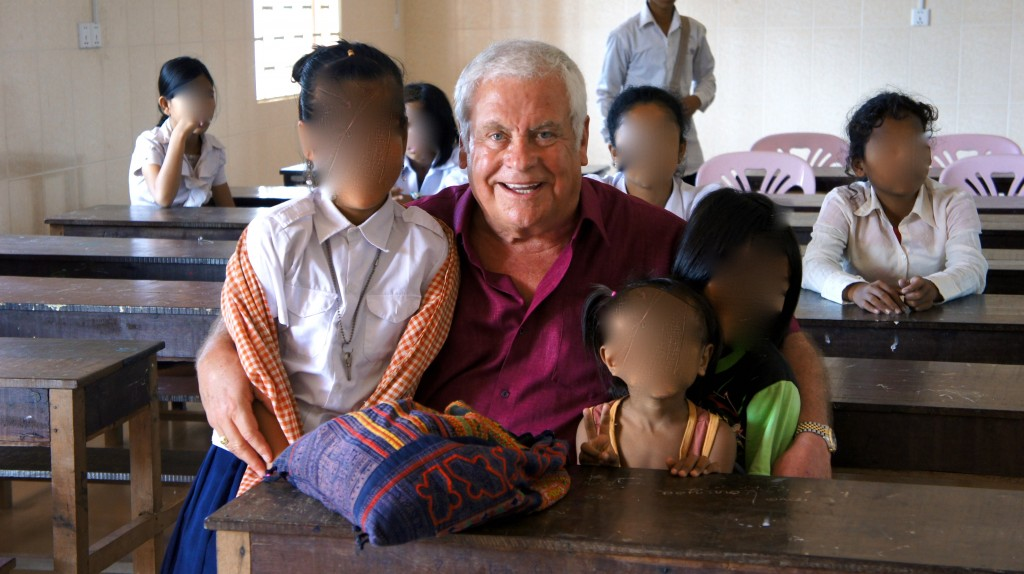 Tom Oliver in Cambodia, working with Connecting Hands. The girl's faces have been obscured for their protection.