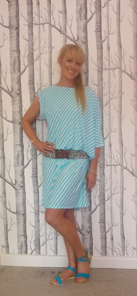 Belle and Beans aqua dress $79.95, Feather sandals $139.95 and Belle and Beans beaded belt $29.95