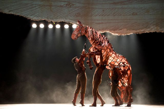 Three puppeteers bring each horse to life