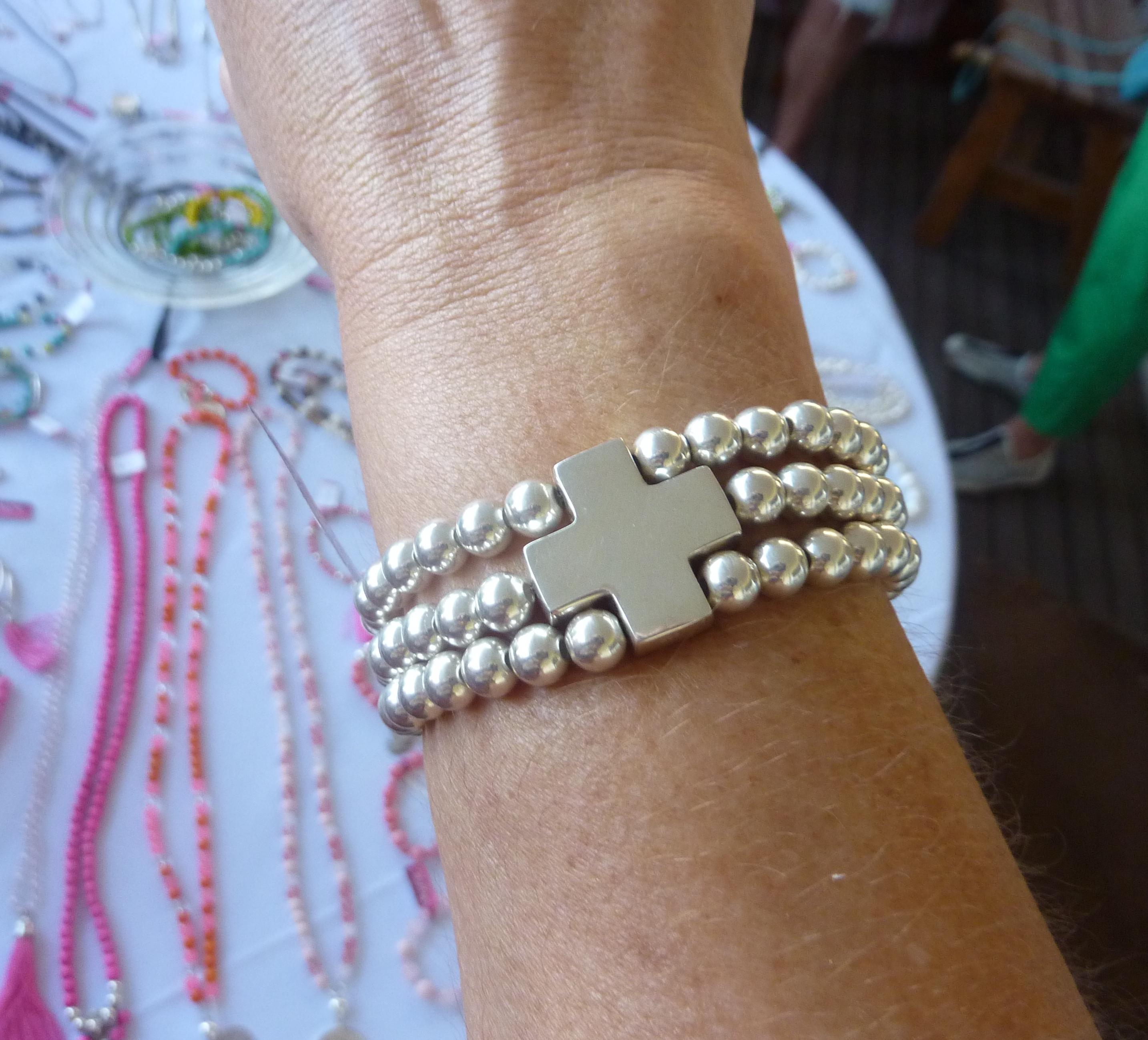 Silver cross bracelet - $150