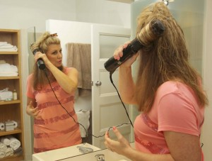 Use the roller button to pull the hair tightly to the scalp