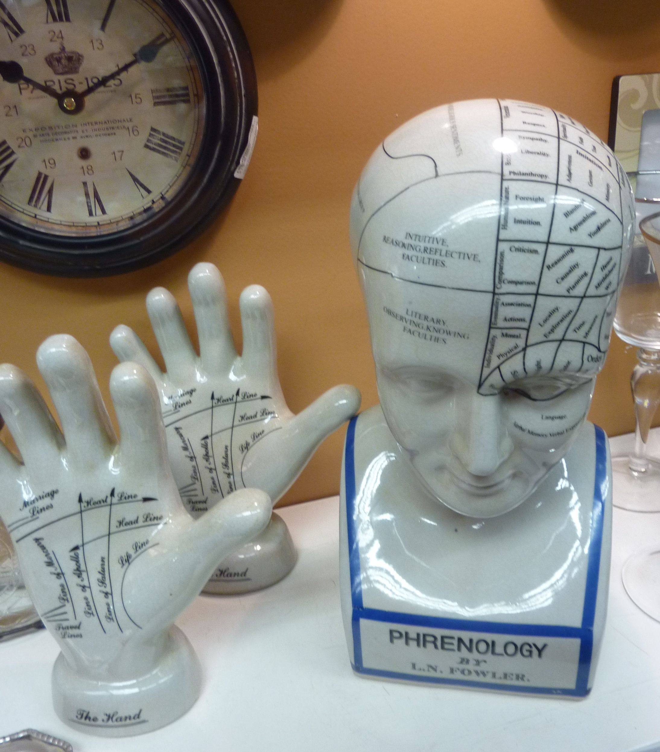 Phrenology head $49.95 and palm-reading hand $28