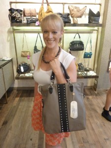 Rochelle wearing Ripple Effect necklace, $79 with Black Theodora studded tote, $279