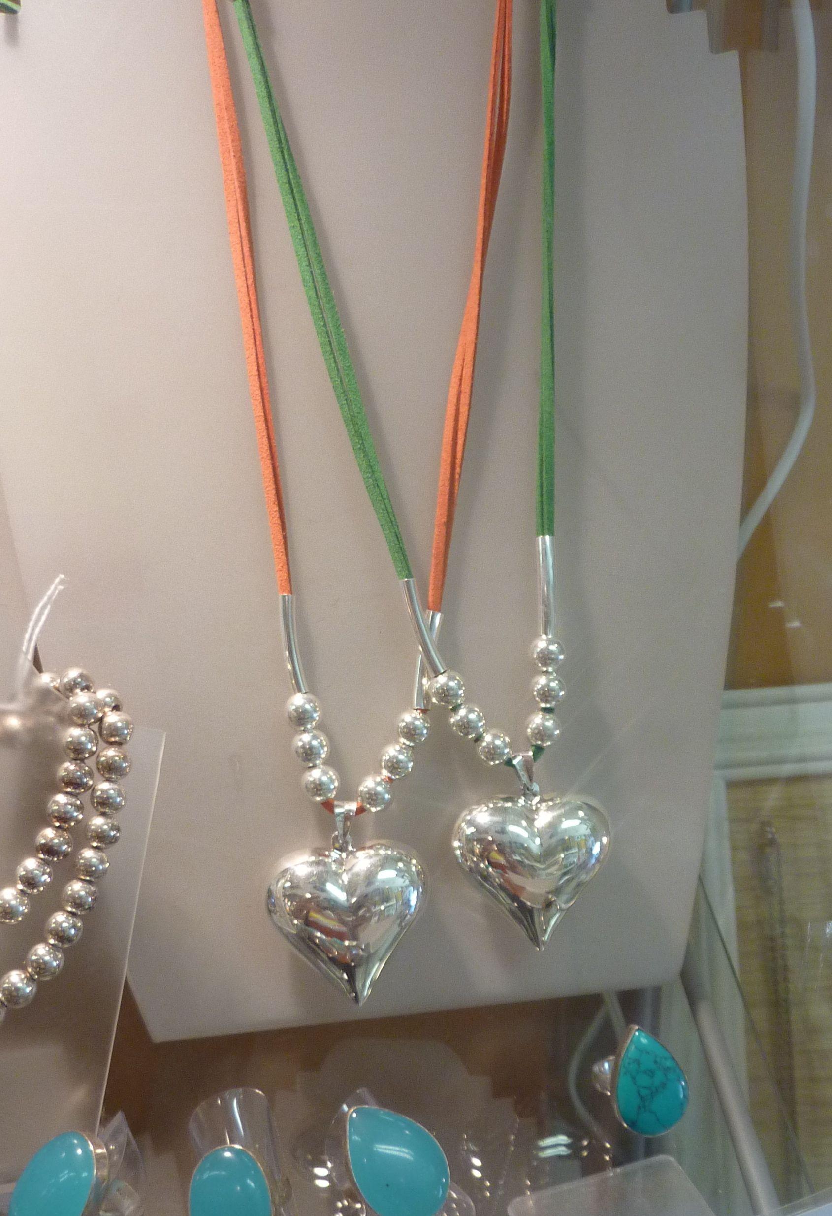 Silver heart pendants - $75