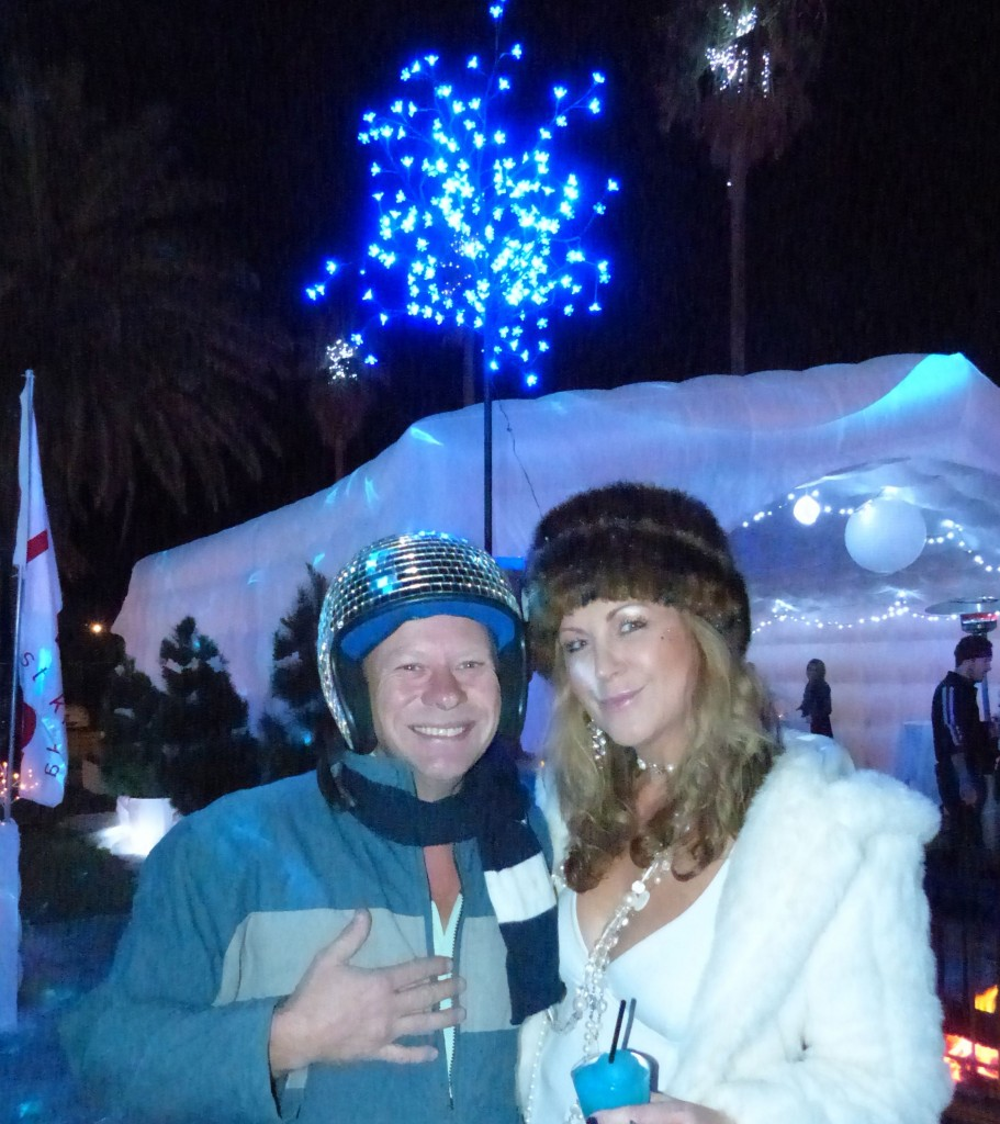 Loving Jason's glitter-ball helmet reflecting the sparkling lights decorating the palm trees