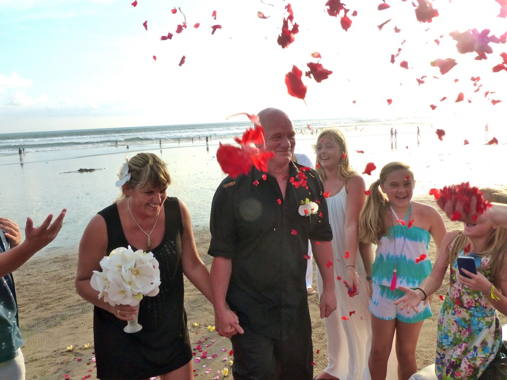 The happy couple were showered with rose petals as they walked back up the aisle...