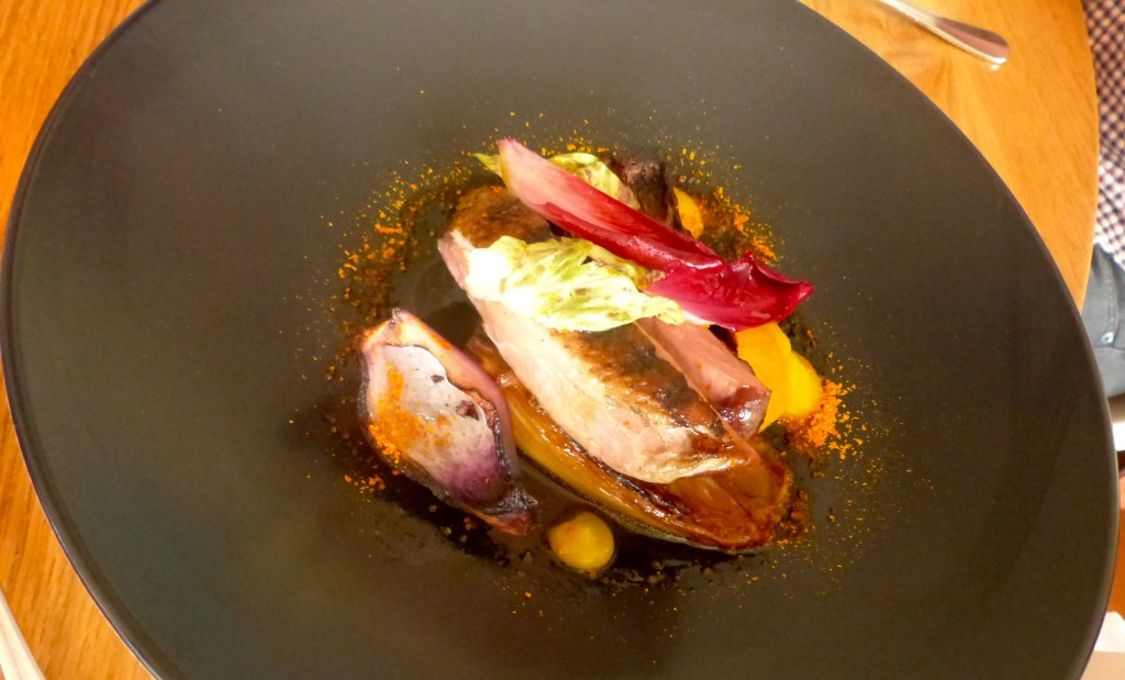 Roasted Milawa duck with tangelo, endive and blackened seasoned onion