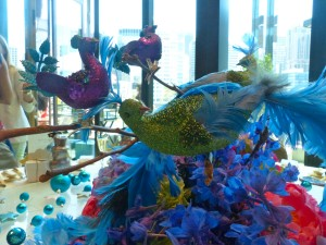 Ornate peacocks sat atop the decadent floral arrangements...