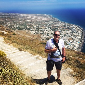 Fletch - climbing to the top of a mountain to see the ancient city of Thira